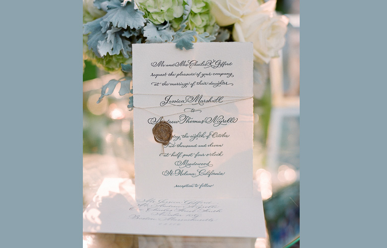 All of the pieces of this classic Flourished Copperplate suite were bound together with gold   thread and a sealing wax stamp. Printed by Elizabeth Hubbell Studio. (Photo by Lisa Lefkowitz.)